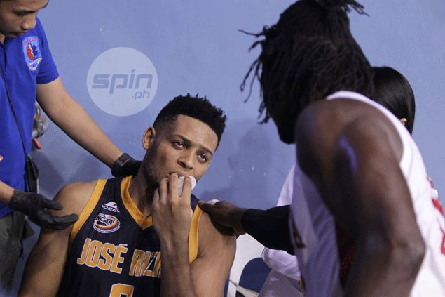 JRU's Abdoul Poutouochi suffers busted lower lip following collision with fellow import Ola Adeogun