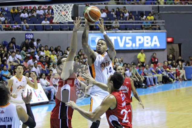 Andre Emmett comes to the rescue as Meralco squeaks past Barangay Ginebra