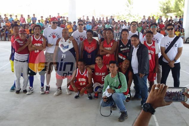Modern covered basketball court rises on remote island hard hit by typhoon Yolanda