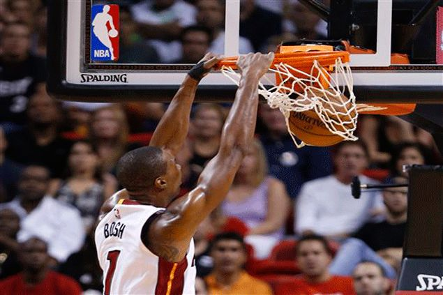 Chris Bosh double-double carries streaking Heat to victory over Cousins-less Kings