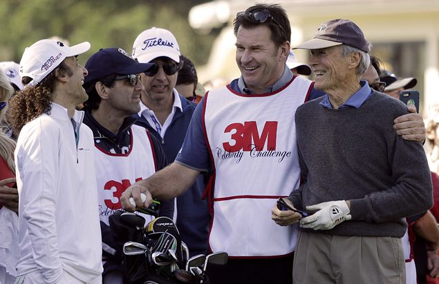 Musician Kenny G has a laugh as many-time major winner Nick Faldo acts as caddie to famed actor/ director Clint Eastwood.