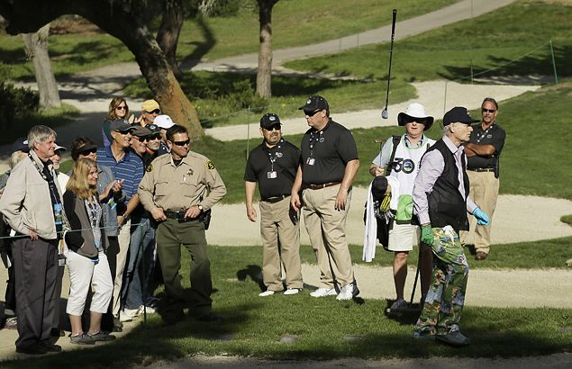 Actor Bill Murray tosses his club after a poor bunker shot.