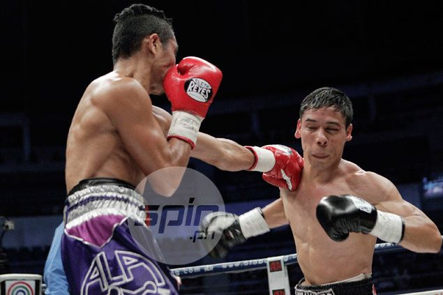 Donnie Nietes retains world title with ninth-round stoppage of Mexican Parra