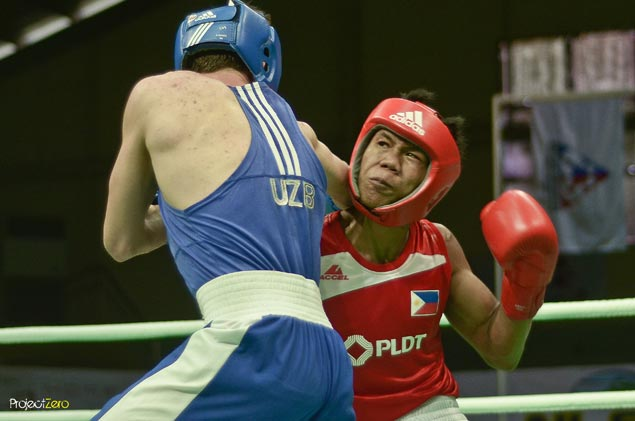 Olympic bid stalls for Eumir Marcial with loss by unanimous decision to Uzbek foe