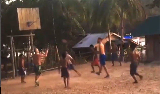 NBA player Evan Fournier plays ball with Palawan kids in dirt court