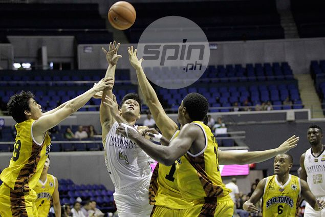 NU Bulldogs down UST Tigers to grab share of third spot and boost bid for twice-to-beat advantage in Final Four