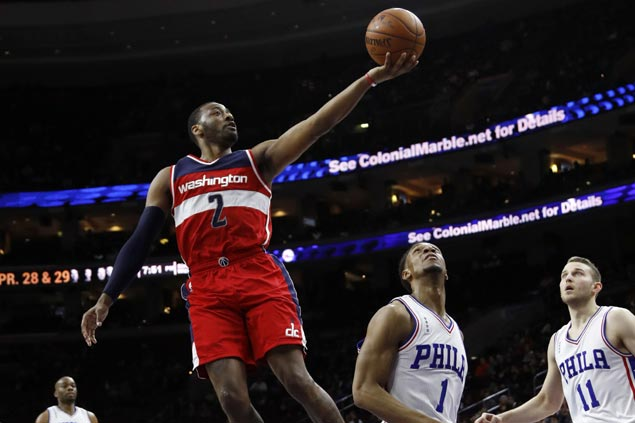 John Wall's triple-double helps Wizards hold off lowly Sixers for third win in a row