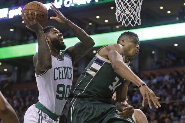 Boston Celtics survive Milwaukee Bucks late push to extend home win streak to 9