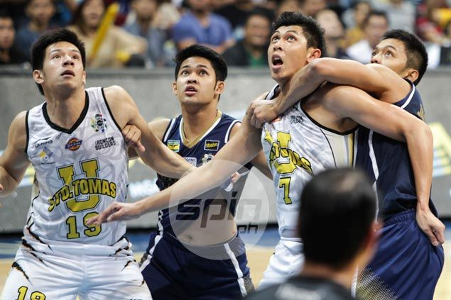 UST Tigers keep share of UAAP lead with vengeful win over reeling NU Bulldogs