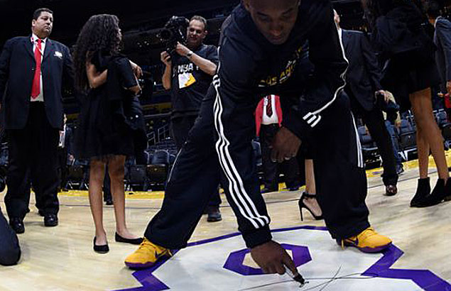 Kobe Bryant-signed piece of Staples Center floor fetches $180,000 in auction