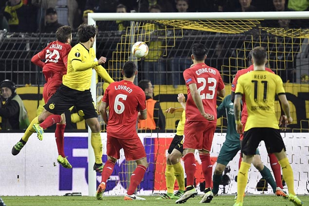 Liverpool holds Borussia Dortmund to a draw in first leg of Europa League quarters