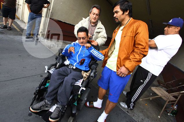 Two cerebral palsy patients wait seven hours for Pacquiao outside gym. Then this