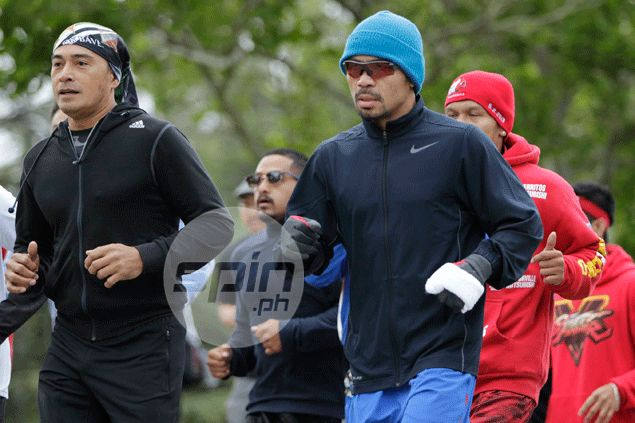 Pacquiao reunites with his biopic trainer in early-morning run in LA