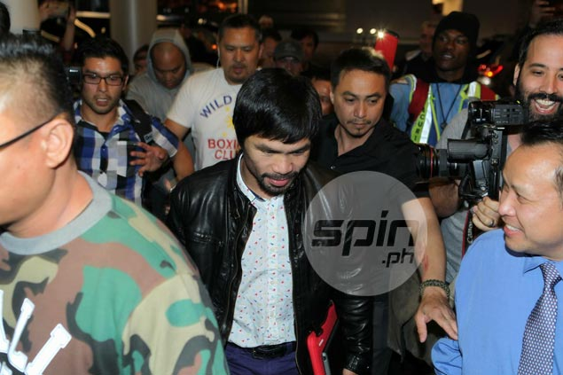 Pacquiao comes home to a grateful nation hoping it isn't the end of great career