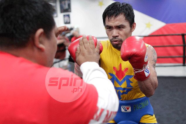 Pacquiao, 2-1 underdog, will put 'bully' Mayweather in his place, vows Roach
