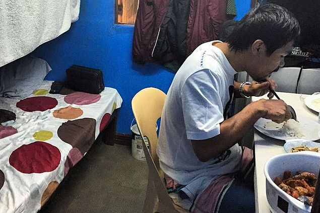 Is that Pacquiao enjoying a meal inside cramped room? Boxing hero explains