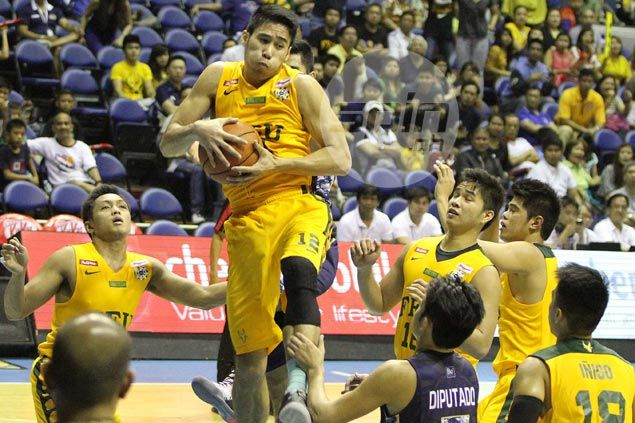 Cruz proves the answer to FEU's prayers as Tamaraws outduel NU Bulldogs in overtime