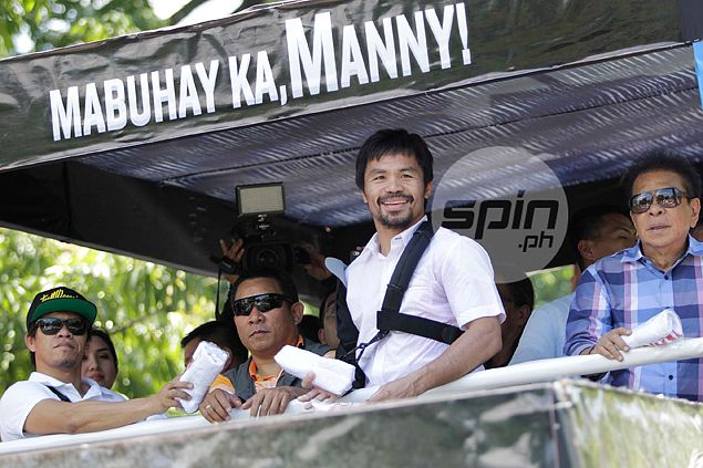 Manny Pacquiao given hero's welcome on return to Philippines