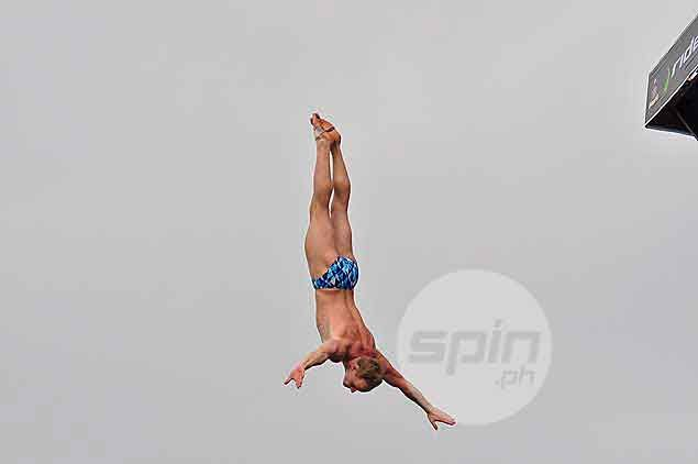 """Germany's Jan Heinzel is a first timer in the country and admitted diving from the 20m platform was """"scary."""" It doesn't show in this dive, though. Dante Peralta"""