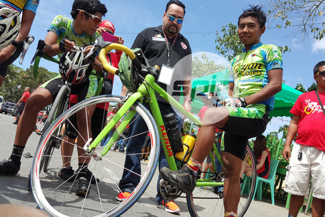 Mindanao teen rider chases dream with an old, metal bike - and steely determination