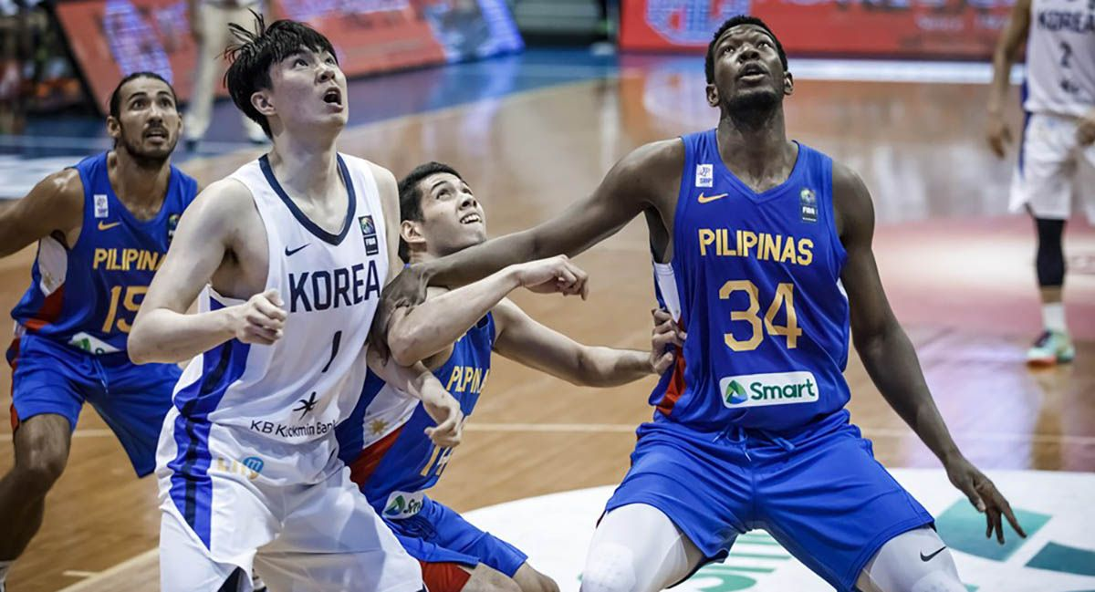 Ange Kouame battles Korea for a rebound