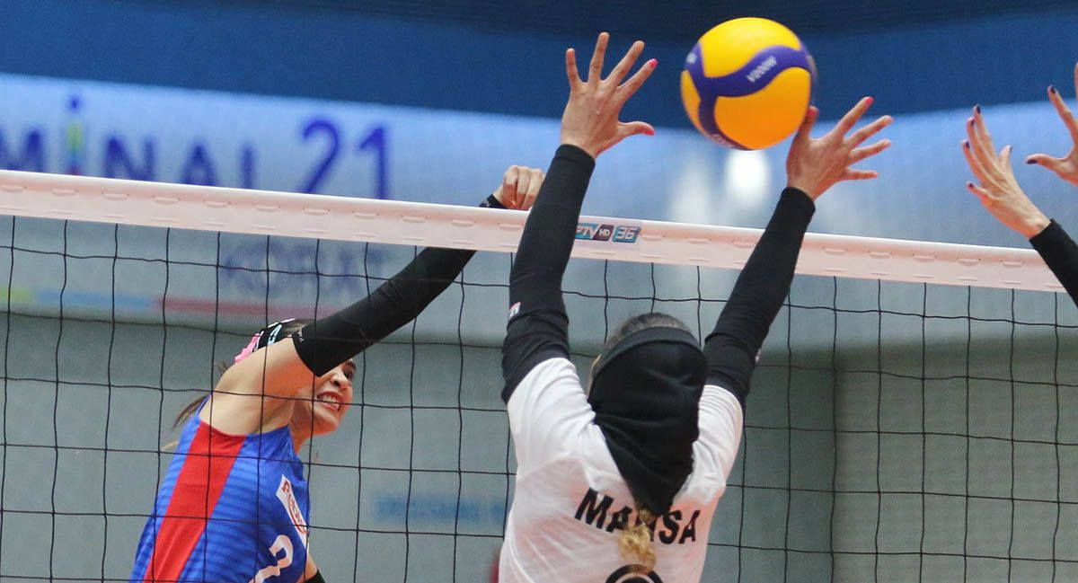Aby Marano of Rebisco delivers a spike against Iran's Saipa