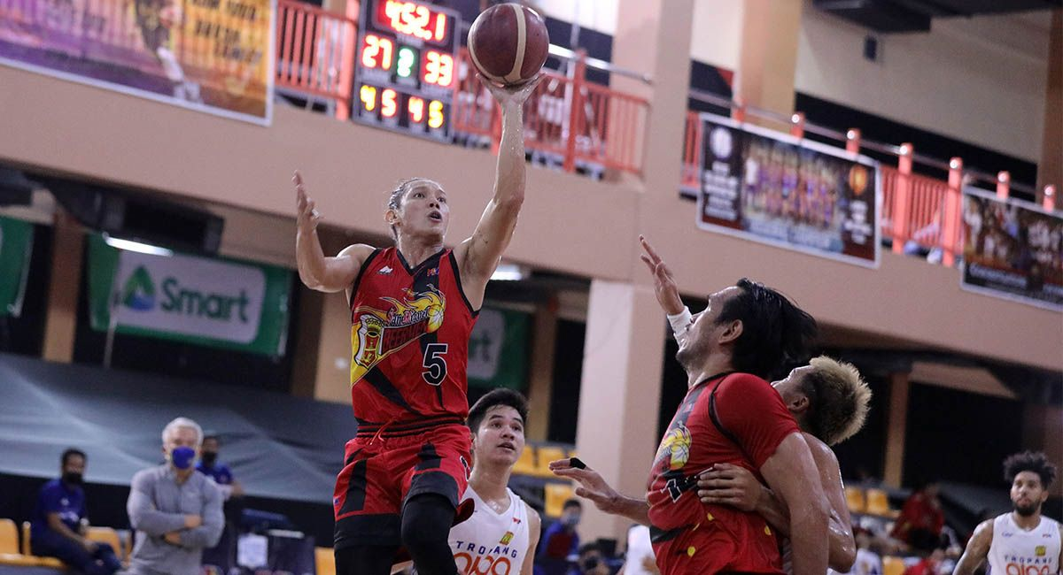 Alex Cabagnot of SMB goes for a drive against TNT