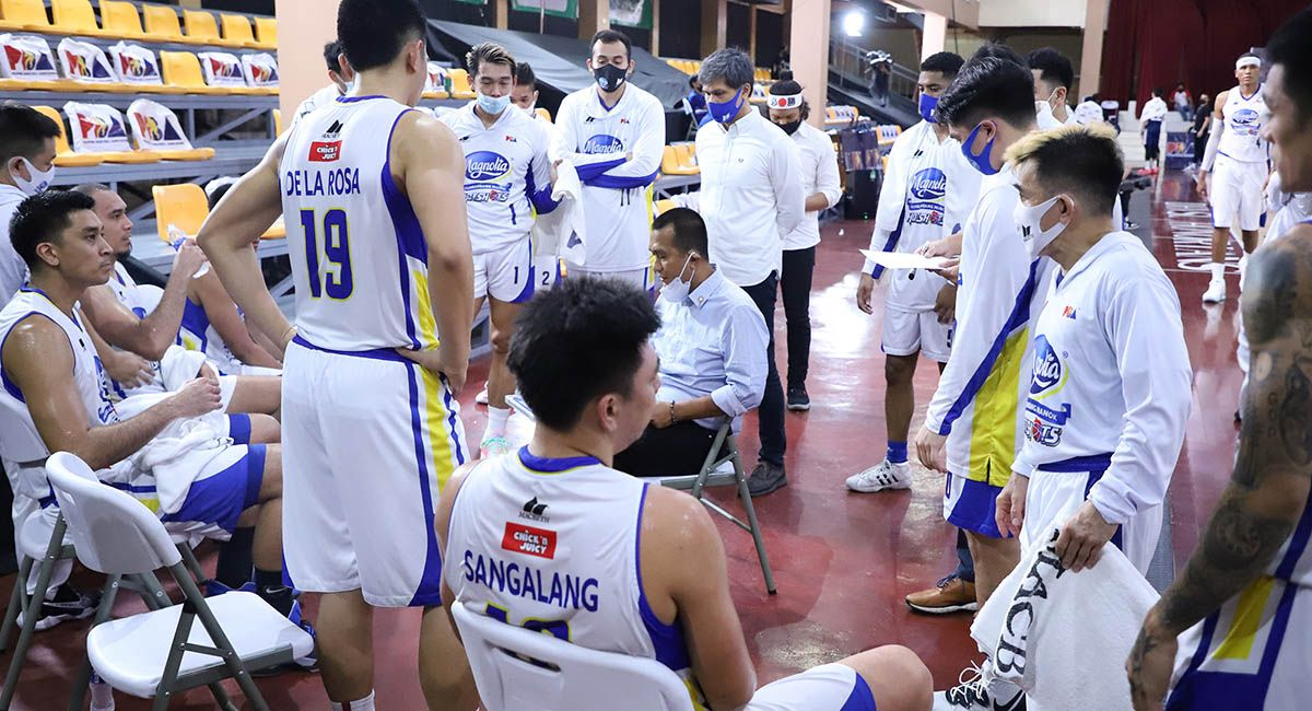 Chito Victolero barks instructions during a Magnolia timeout.