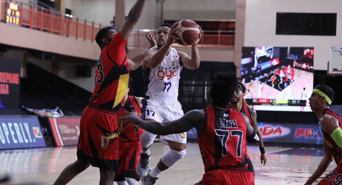 Jayson Castro of TNT drives against San Miguel