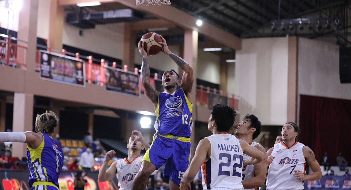 Magnolia forward Calvin Abueva towers for a jumper against Meralco in Game Two.