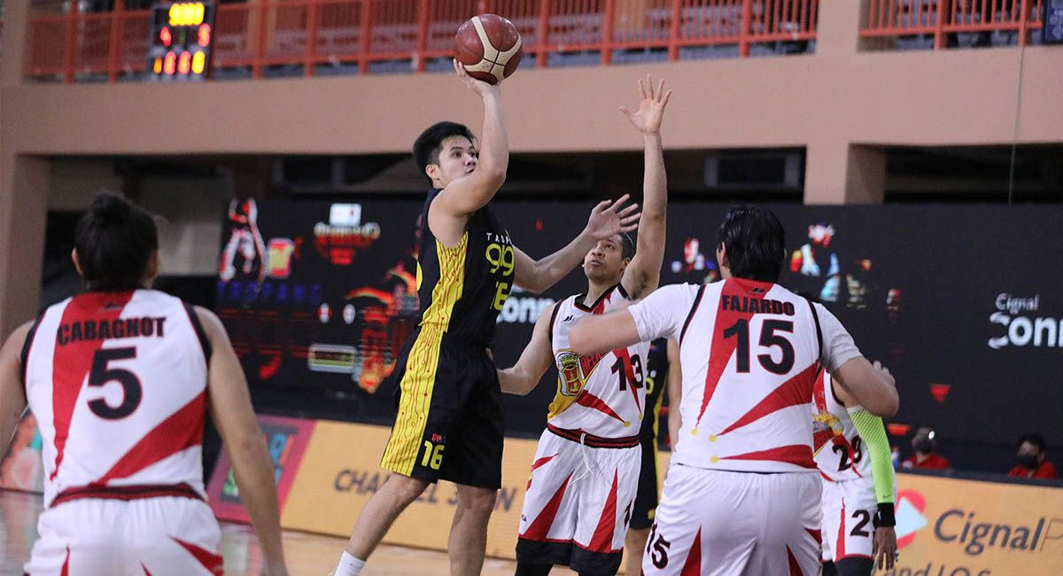RR Pogoy of TNT goes for a jumper against San Miguel