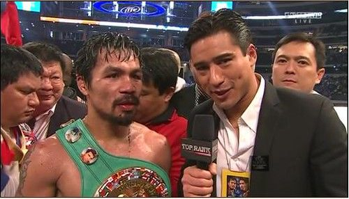 Manny Pacquiao being interviewed atop the ring with Jayke Joson in the background.