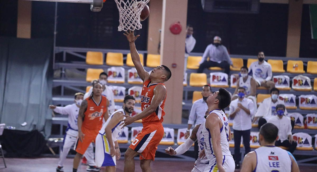 Meralco guard Nards Pinto goes for a drive against Magnolia in Game Three.