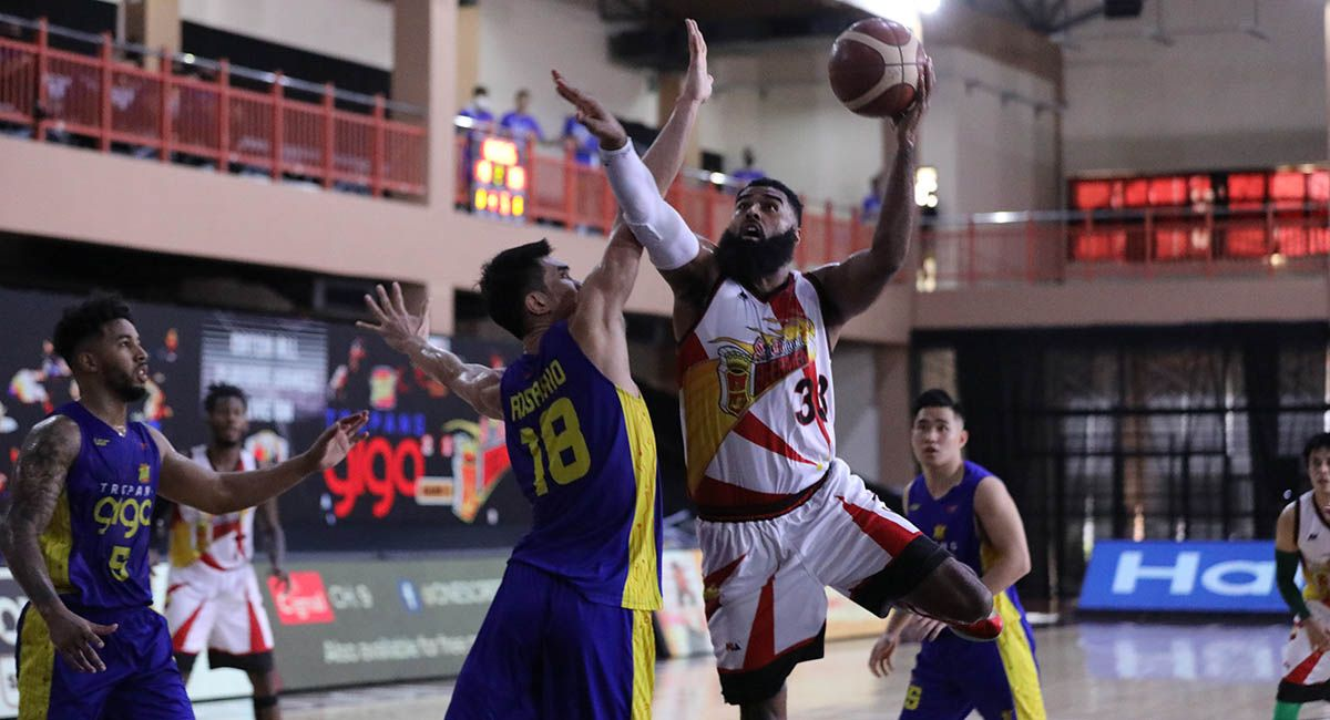 SMB big man Mo Tautuaa scores inside against TNT's Troy Rosario in Game 4.
