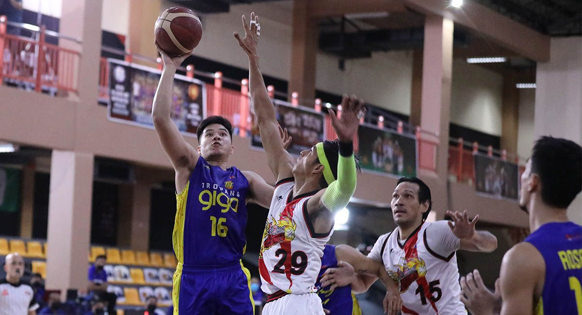 RR Pogoy of TNT goes for a short stab against SMB defender Arwind Santos in Game 4.