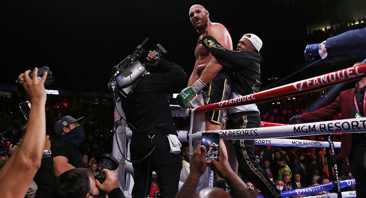 Tyson Fury celebrates his 11th-round knockout of Deontay Wilder in the third fight of their trilogy.