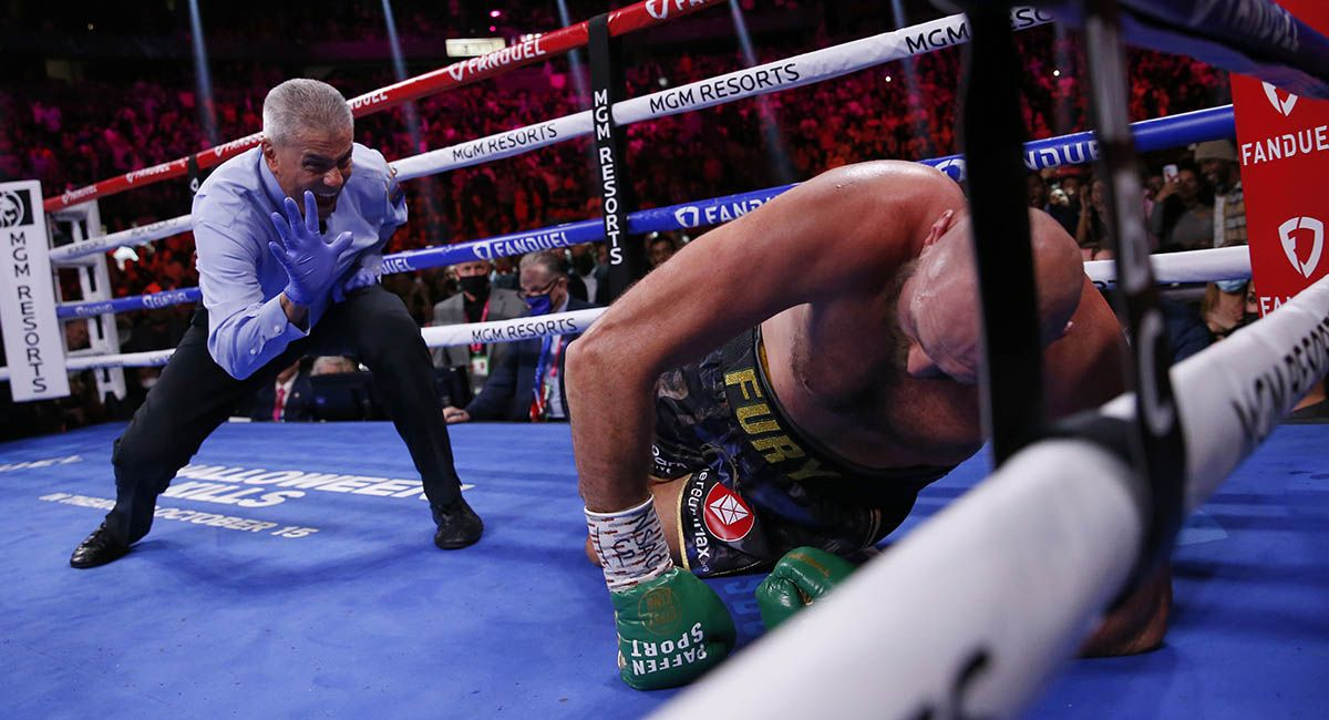 Tyson Fury struggles to get up from an early knockdown.
