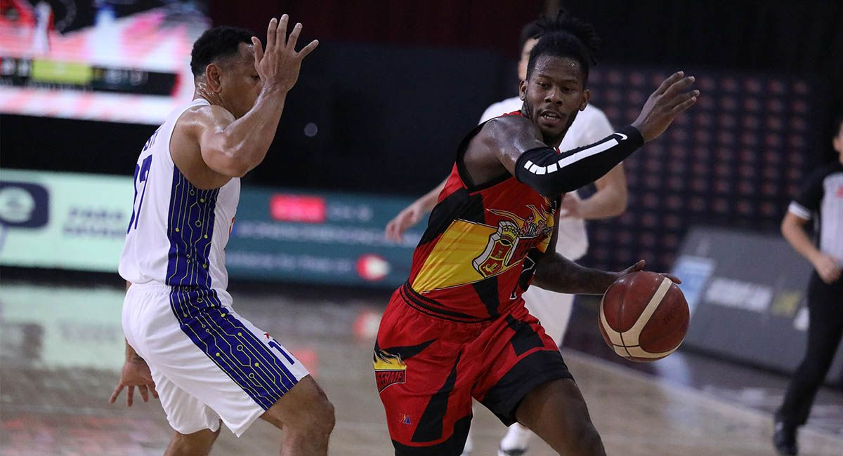 CJ Perez, seen being defended by TNT's Jayson Castro, has embraced the sixth man role at San Miguel.