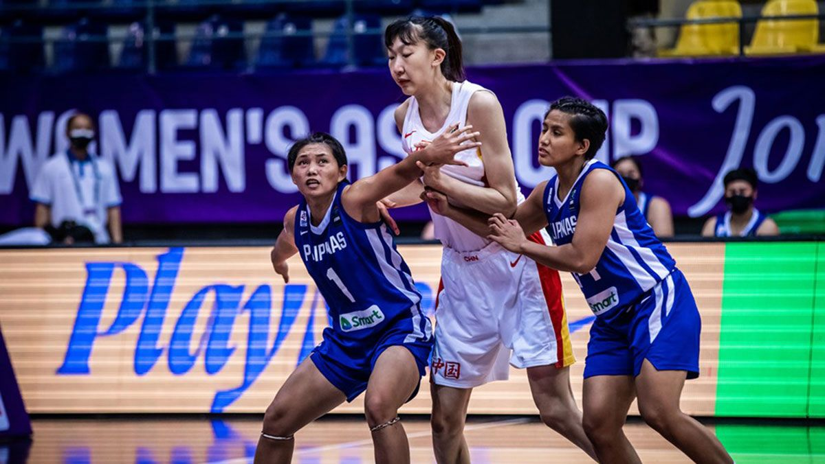 Gilas Women's size woes are evident in this photo where Mar Prado and Kristine Cayabyab try to box out 6-foot-9 center Xu Han.
