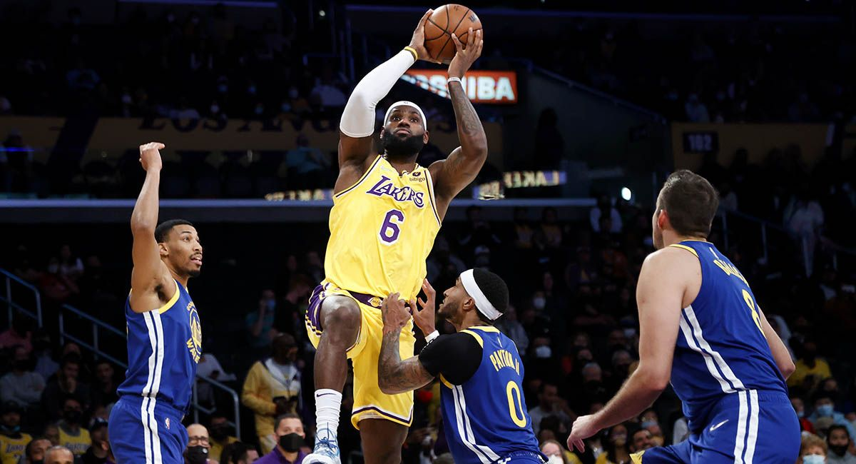 LA star LeBron James takes off for a layup in a preseason game against the Warriors.