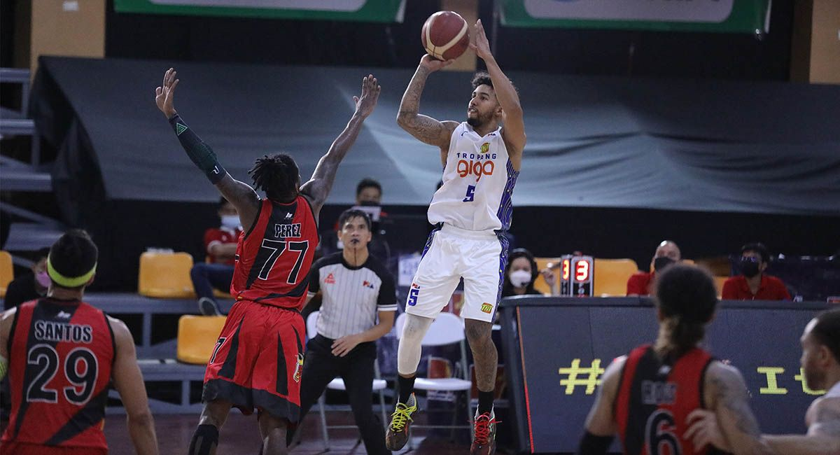 TNT rookie Mikey Williams pulls up for a jumper against SMB's CJ Perez in Game Five.