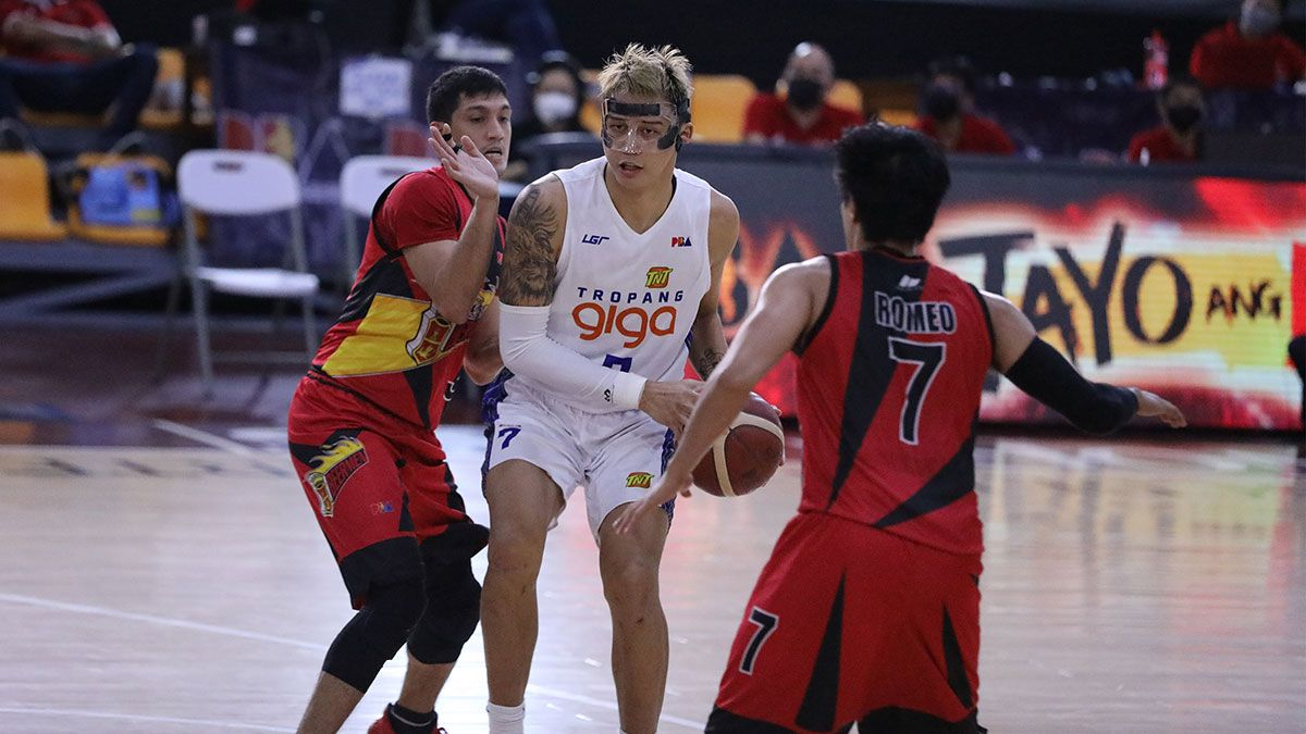 Poy Erram tries to get through Von Pessumal and Terrence Romeo in Game 5 of TNT vs SMB.