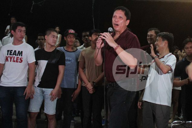 Banned coach Rey Madrid very much a part of UP victory, says Ramil Cruz, players