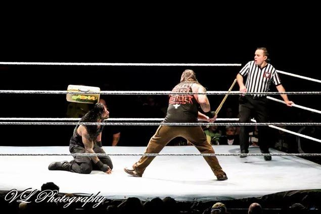 WWE fanarrested in Canada for throwing a briefcase at wrestler Roman Reigns