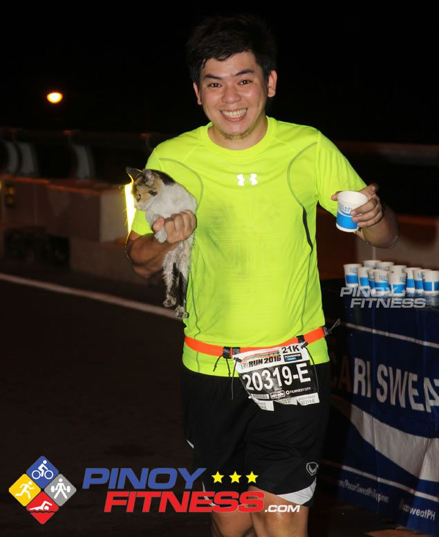 Marathoner Magnaye recounts why he finished race with stray cat in his arms