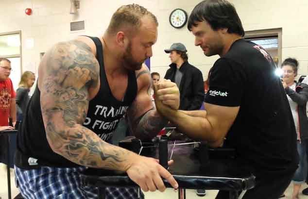 WATCH World arm-wrestling champ cuts Game of Thrones' 'The Mountain' down to size